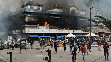 A local market is seen burning during a protest in Fakfak, Papua province, on August 21.