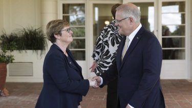 Prime Minister Scott Morrison with Senator Linda Reynolds after she was sworn in as Minister for Defence Industry at Government House in Canberra on Saturday.