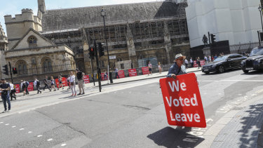 Some demonstrators gathered across the road near the Houses of Parliament on Wednesday.