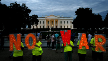 Protesters make their demands known outside the White House on Thursday.
