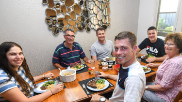 Just like home: British doubles players Neal Skupski (front, centre), and brother Ken (right, rear) are staying with the Lustig family of Caulfield North.