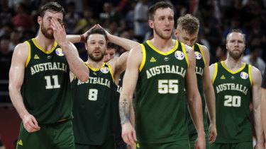 Hoop dreams shattered:  Australian players (from left) Nick Kay, Matthew Dellavedova, Mitch Creek, and David Barlow react after the loss to France in third-place play-off at the FIBA Basketball World Cup in Beijing.