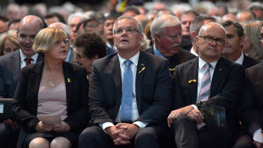 Police Minister Lisa Neville with Prime Minister Scott Morrison and former chief commissioner Ken Lay.