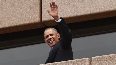 Former US president Barack Obama waves to people at the Sydney Opera House on Friday.