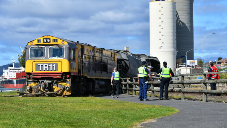 Tasmania train derailment: Two people hurt as freight train derails