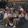 Parisians enjoy the late summer weather in packed cafes and restaurants despite the recent surge in COVID-19 infections.