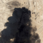 A satellite image from Planet Labs shows thick black smoke rising from Saudi Aramco's Abqaiq oil processing facility in Buqyaq, Saudi Arabia.