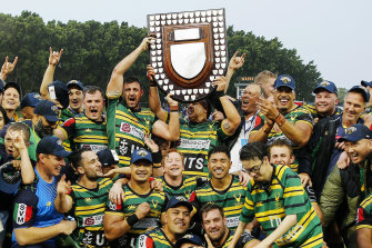 Gordon players with the Shute Shield after their 28-8 victory over Eastwood.