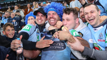 James Tedesco celebrates with fans after after NSW's series victory last year.