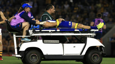 Knock-out blow: North Melbourne's Shaun Higgins  is stretchered off the ground.