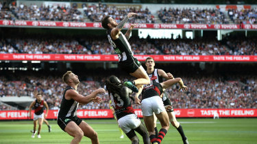 Jeremy Howe flys over Joe Daniher.