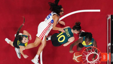 Ezi Magbegor #13, Katie Ebzery #10 and Tess Lavey #12 of Team Australia fight for possession of a rebound with Isalys Quinones #25 of Team Puerto Rico.