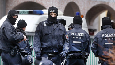 German police officers stand guard in front of a mosque during a previous terror raid in Frankfurt.