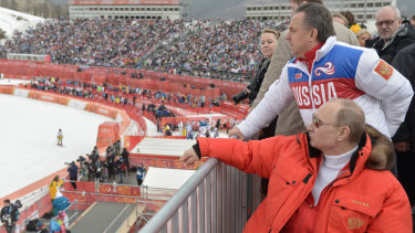 Russian president Vladimir Putin and sports minister Vitaly Mutko survey the scene at the 2014 winter Games in Sochi.