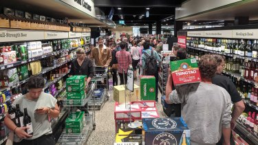 The line at Dan Murphy's in Brunswick on Sunday snakes up one side of the aisle and down the other.
