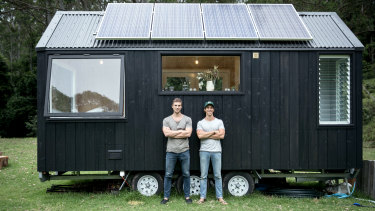 Brothers Chris and Cam Grant with one of their tiny houses.