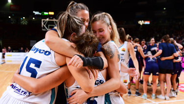 Dream debut: The Flyers celebrate after sealing a spot in the WNBL grand final series.