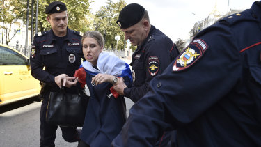 Police detain Lyubov Sobol prior to an unsanctioned rally in Moscow in July.