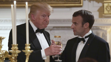Donald Trump, left, and Emmanuel Macron, share a toast during the State Dinner at the White House.