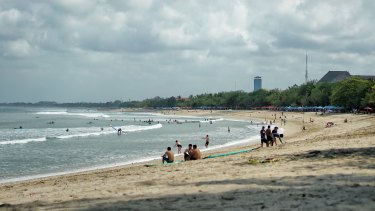 The two-kilometre stretch of sand at Kuta Beach is popular with holidaymakers.