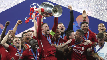 Six times: Liverpool captain Jordan Henderson and teammates with the Champions League trophy.
