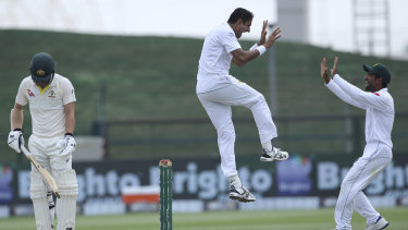 Pakistan's Mohammad Abbas celebrates the dismissal of Australia's Travis Head during a Test series last year.
