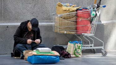 In early May, in the midst of COVID-19, a homeless man sits in George Street, Sydney.