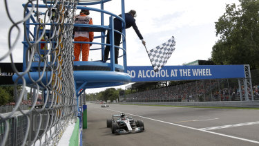 Lewis Hamilton takes the chequered flag for Mercedes to win the Italian Grand Prix at Monza on Sunday.