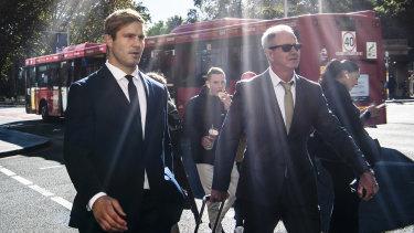 Jack De Belin (left) arrives at the Downing Centre on Wednesday.