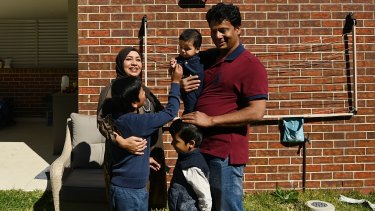 Mohammed Islam with his wife Afsana Fardous and their sons four-year-old Diyan Islam, eight-year-old Shayan Islam and six month-old Sinan Islam in the backyard of their home in Hurstville.