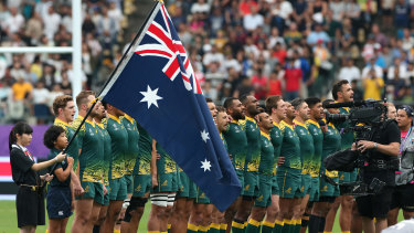 Australian players line up for the national anthem prior to the Rugby World Cup between Australia and Uruguay at Oita Stadium in 2019