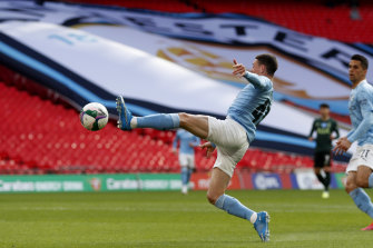 Manchester City's Phil Foden reaches for the ball.