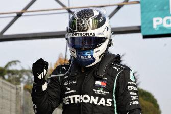 Valtteri Bottas celebrates taking pole at Imola.