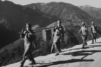 Indian troops carry ammunition during the conflict between China and India in 1962.