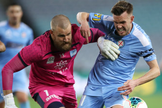 City's Craig Noone, right, and formidable Sydney keeper Andrew Redmayne,  left, in action.