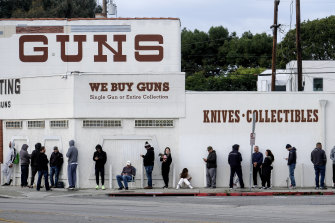 People wait in line to enter a gun store in Culver City, California during the rush on guns earlier this month.