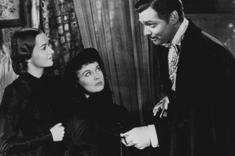 Olivia De Havilland, Vivien Leigh and Clark Gable in Gone With The Wind.
