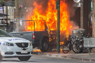 The scene on Bourke Street where Shire Ali set a car alight before killing the co-owner of Pellegrini's Espresso Bar and wounding two others in a suspected act of terror.