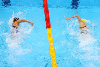 Katie Ledecky (left) and Ariarne Titmus in their Olympic showdown in the 400m freestyle.