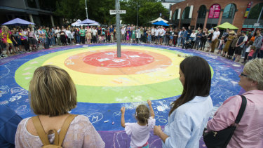 The circle of love at the rainbow roundabout on Lonsdale Street during Saturday's Yes!Fest.