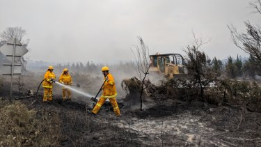 Fire crews continued to work on the fireground Saturday morning.