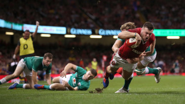 Minor comeback: Owen Lane dives over to score Wales' first try against Ireland.