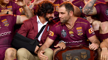 Red letter day: Johnathan Thurston and Cameron Smith had a good chat over a glass of red about rep retirement.