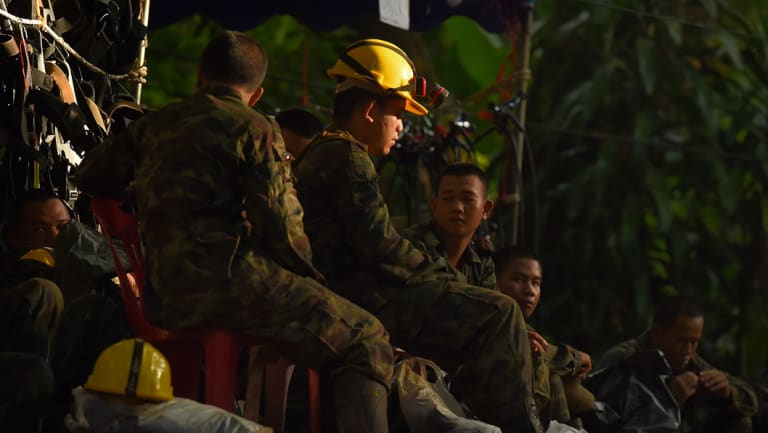 Thai army soldiers rest at the base camp before going to Tham Luang cave.