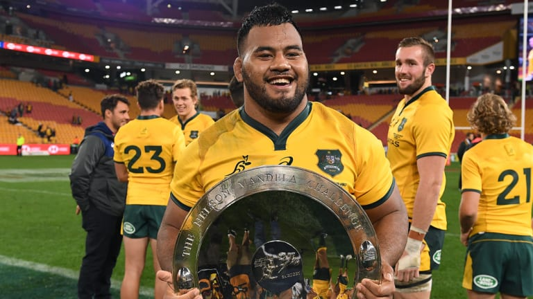 Impressive: Taniela Tupou holds the Mandela Plate after the Wallabies' win in Brisbane.