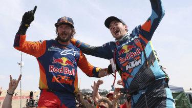 Pain barrier: Australia's Toby Price (left) celebrates with runner-up Matthias Walkner of Austria.