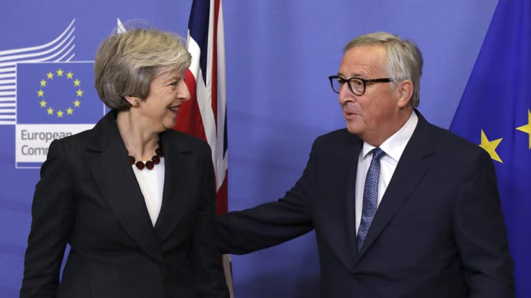 European Commission president Jean-Claude Juncker with British Prime Minister Theresa May in Brussels on Wednesday.