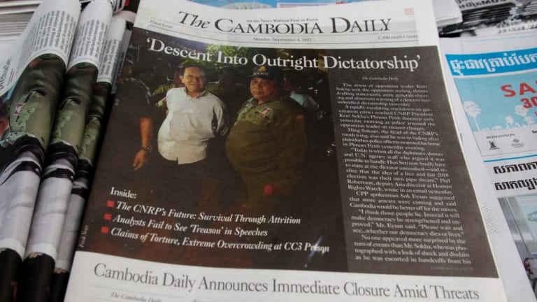 The final issue of The Cambodia Daily is sold at a newsstand, in Phnom Penh last September.
