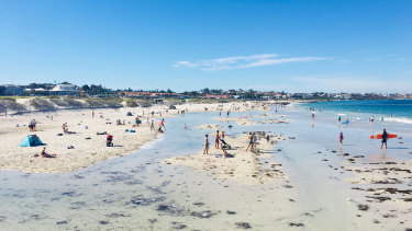Beaches in Sorrento and Hillarys were packed by 10am on Friday.