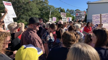 'Time to go Lammo': Crowd rallies near Laming's Qld office